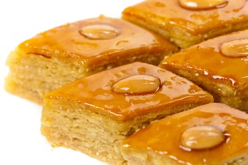 Baklava with almonds on white background