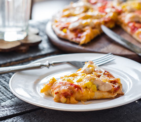 slice of pizza with chicken, corn, tomatoes and double cheese