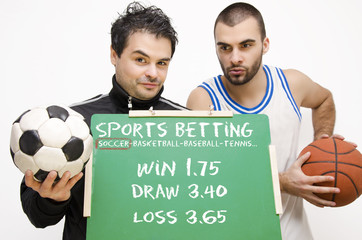 Sports betting athletes holding blackboard with odds