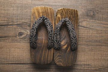 wooden sandal on wooden floor