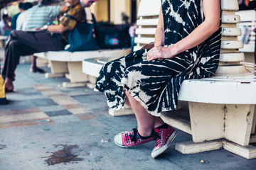Young woman waiting at train station