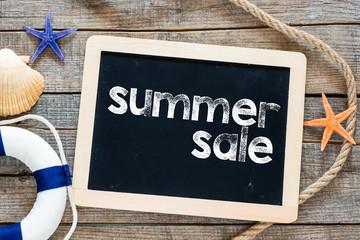 Summer sale Text on blackboard