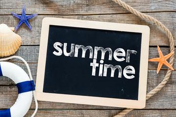 Summer time Text on blackboard