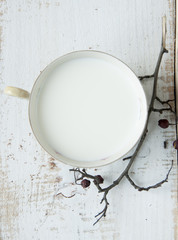 Cup of milk on wooden background. Top view