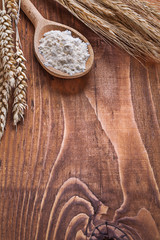 copyspace image wooden spoon with ears of wheat on old bo