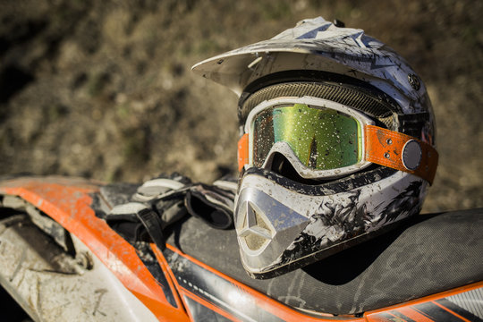 Dirty motorcycle motocross helmet with goggles