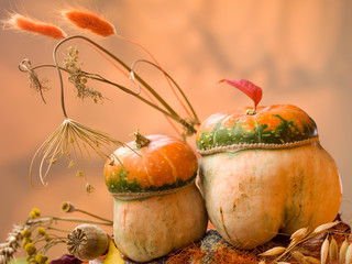 2 decorative pumpkin with grass and spikelets