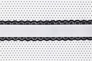 Black and white retro polka dot textile background with ribbon