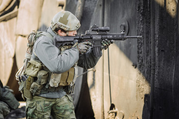 military soldier shooting an assault rifle