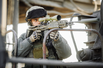 military soldier shooting an sniper rifle