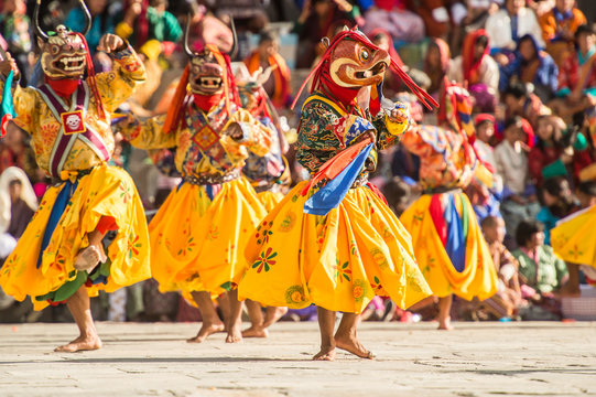 THIMPHU BHUTAN SEPTEMBER 27 2012 : Costumed monk performs tradition dance in tsechu festival at Thimphu Bhutan