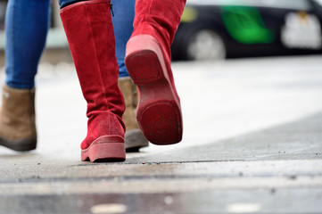 Close up of boots, woman walking