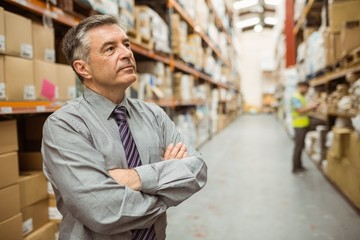 Thoughtful businessman with crossed arms
