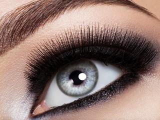 woman's eye with black eye makeup. Macro style image