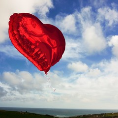 Wall Mural - Composite image of red heart balloon