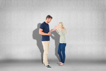 Composite image of young couple having an argument