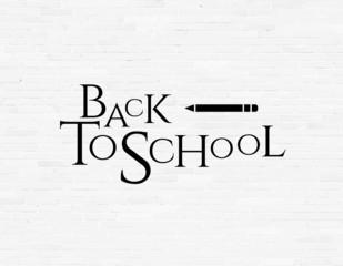 Back to school phrase on white brick wall