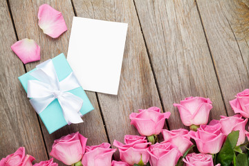Pink roses and valentines day greeting card or photo frame and g