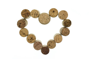 Wine corks form a heart shape image isolated on white