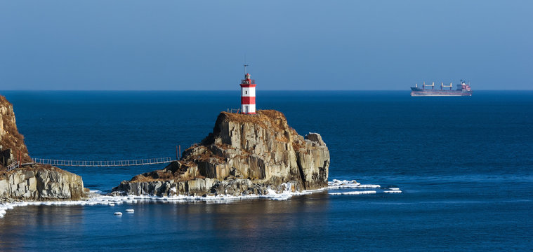Lighthouse on a cliff by the sea. East (Japan) Sea.