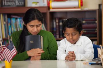 HIspanic Mom and Boy in Homeschool Setting During Worship