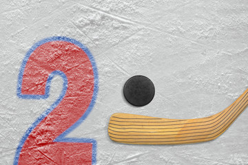 Hockey stick, puck and the numeral two