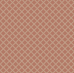 Pattern of small squares on terracotta background.