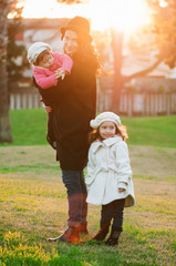 Beautiful young mother and kids in the park, selective focus