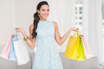 Stylish brunette with shopping bags
