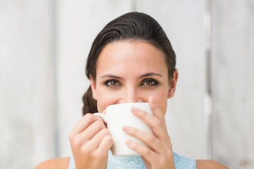 Stylish brunette holding a mug