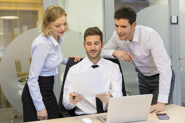 Group of business people working in office on computer