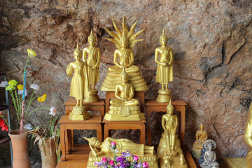 golden buddha image in the cave