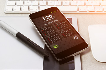 Workplace with mobile phone and calendar.Workplace with mobile p