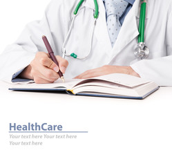 male doctor hands making notes in office
