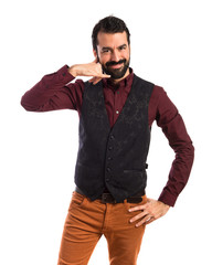 Man wearing waistcoat making phone gesture