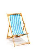 Blue beach sunbed isolated on white