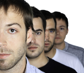group of men in front of a white background