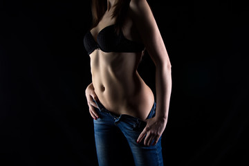 Image of the sexy woman's body in jeans