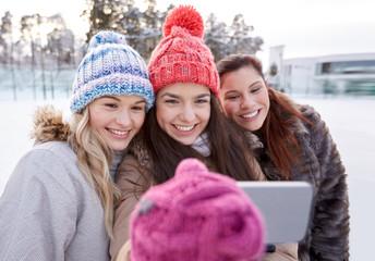 happy teenage girls taking selfie with smartphone
