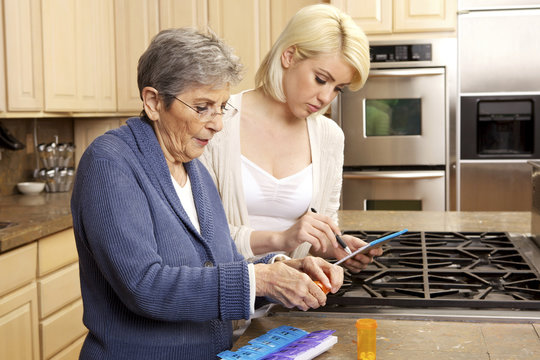Senior Women Getting Help Organizing Her Prescription Medicine