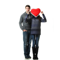 couple having fun with a pillow in the form of heart