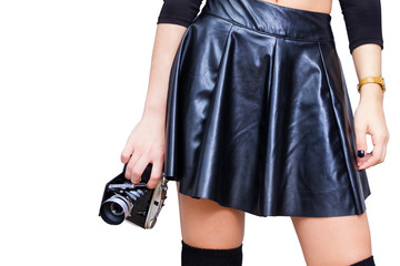 Girl with leather skirt and vintage camera isolated