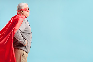 Studio shot of a senior in a superhero outfit