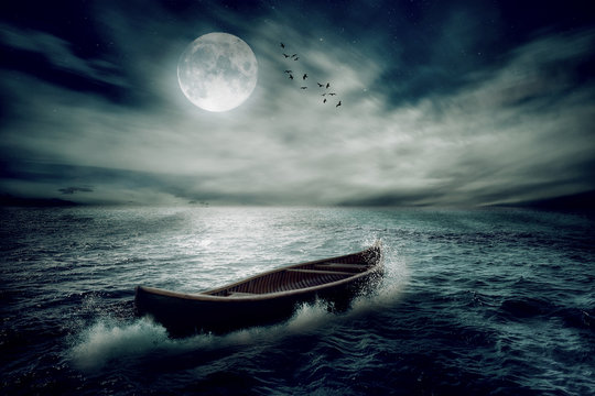 Boat drifting away on moonlight background in middle ocean