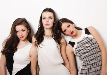 Three elegant beautiful girls posing