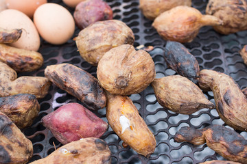 eggs and potato on the grill