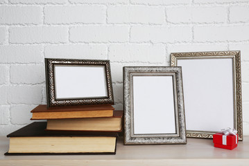 Golden photo frames with books and present box