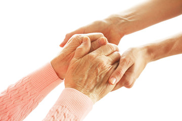 Old and young holding hands, isolated on white
