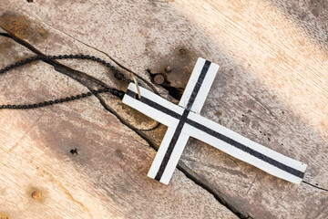 Cross placed flat on the wooden