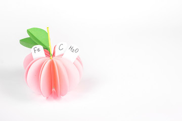 isolated paper apple with vitamin